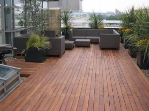 Hardwood Decking of penthouse apartment with seating and plants