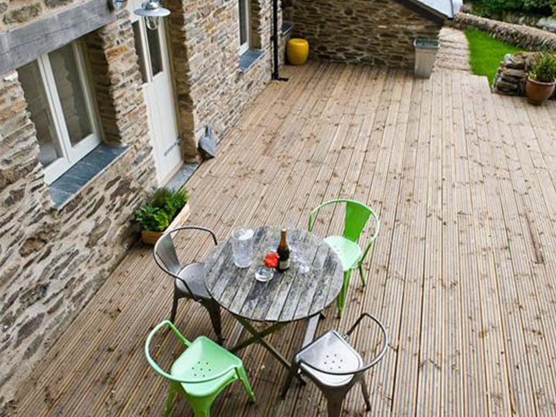 Softwood Decking outside home with table and chairs in foreground
