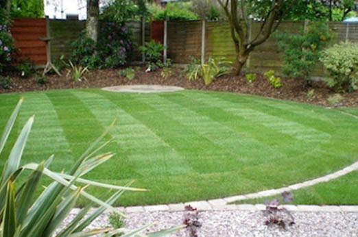 large circular Natural Lawn with square mown pattern