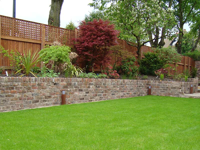Raised wall surrounded garden hosting flower beds