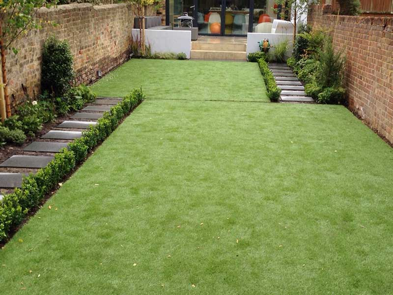 two square Synthetic Lawns with paths at either side